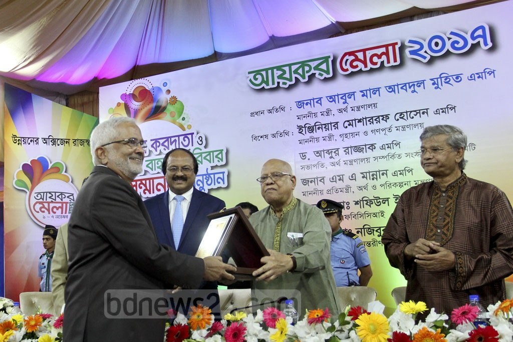 Finance Minister AMA Muhith joined the National Board of Revenue's ceremony to honour the best taxpayers of the year on Wednesday. Photo: asif mahmud ove