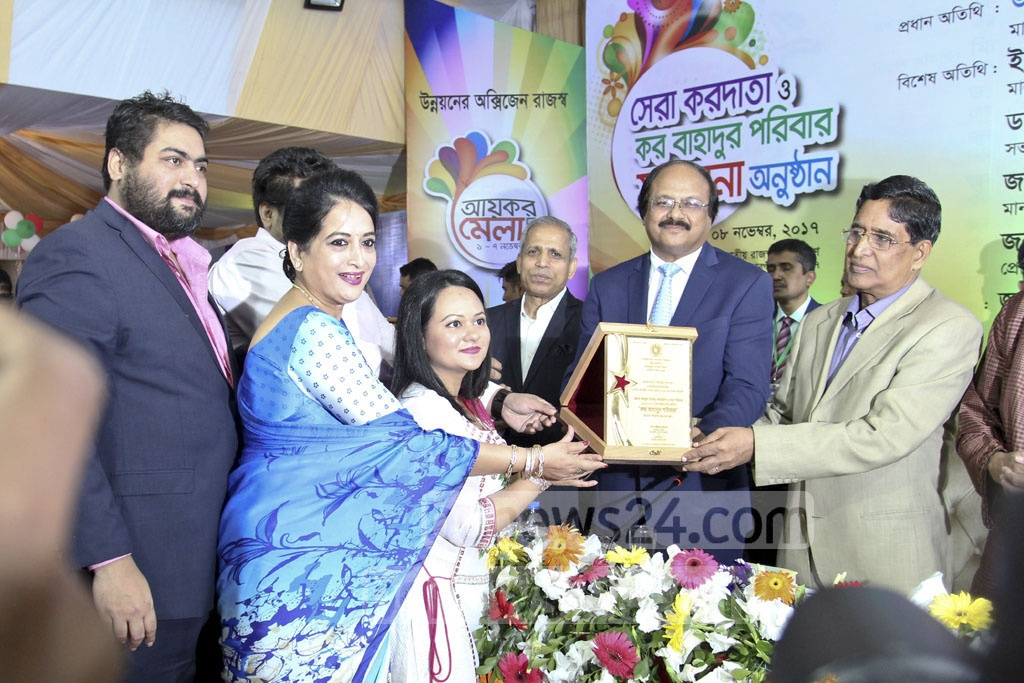 Nitol-Niloy Group Chairman Abdul Matlub Ahmed's family received the honour of 'Kor Bahadur'. Ahmed's wife Selima, vice-chairman of the group recieved the award with her children on Wednesday. Photo: asif mahmud ove