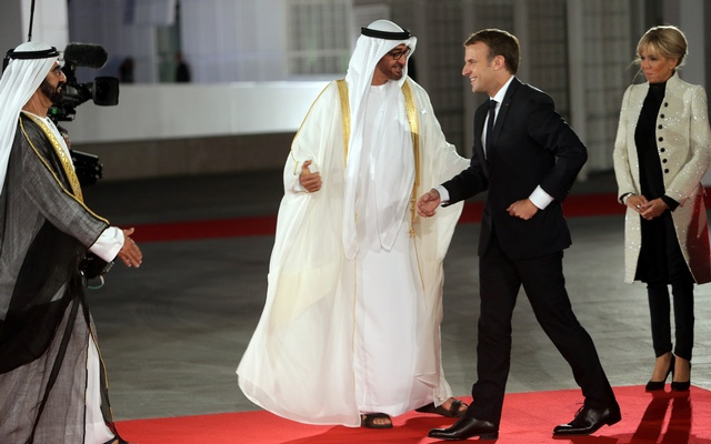 French President Emmanuel Macron is welcomed by Abu Dhabi Crown Prince Sheikh Mohammed bin Zayed al-Nahyan and Prime Minister and Vice-President of UAE and Ruler of Dubai Sheikh Mohammed bin Rashid al-Maktoum at the Louvre Abu Dhabi. Reuters