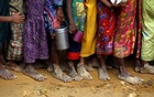 Bare feet of Rohingya refugee children are pictured as they stand in a queue while waiting to receive food outside the distribution centre in Palongkhali makeshift refugee camp in Cox's Bazar, Bangladesh Nov 7, 2017. Reuters