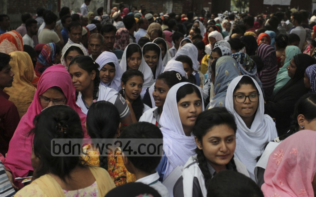 Students outside the JSC exam centre at Dhaka's Sher-e-Bangla Nagar High School after the test on Thursday. Photo: asif mahmud ove