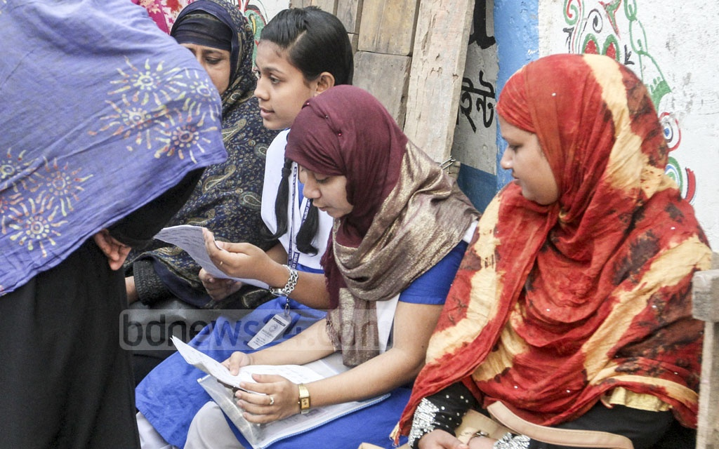 Students outside the JSC exam centre at the Dhaka Govt Muslim High School in Old Dhaka before the test on Thursday. Photo: dipu malakar
