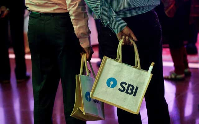 The State Bank of India (SBI) logo is seen on bags carried by participants during a news conference in Mumbai, India October 30, 2017. Reuters