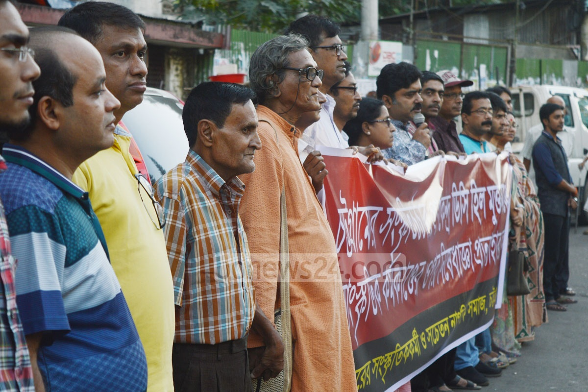 Cultural activists form a human-chain at Cheragi Square in Chittagong on Saturday demanding withdrawal of a ban on organising cultural activities at DC Hill in the port city. Photo: suman babu