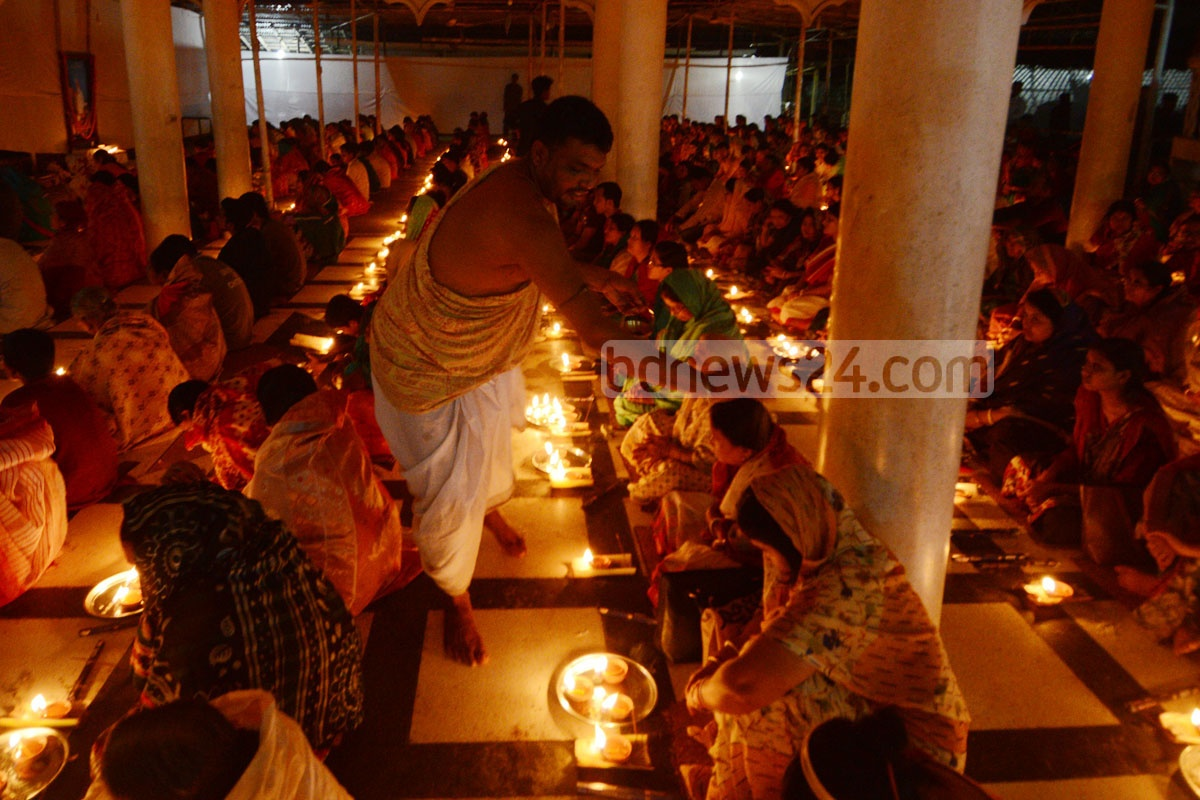 Hindu devotees pray after day-long fasting as part of Rakher Upabash or Kartik Brata rituals for the well-being of their loved ones at the Loknath Ashram in Chittagong on Saturday. Photo: suman babu