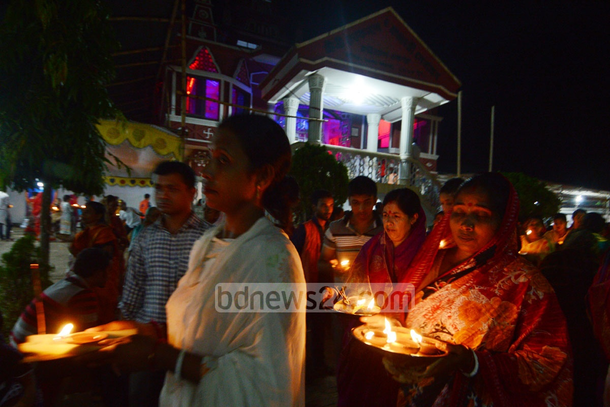 Hindu devotees perform Rakher Upabash or Kartik Brata rituals for the well-being of their loved ones at the Loknath Ashram in Chittagong on Saturday. Photo: suman babu