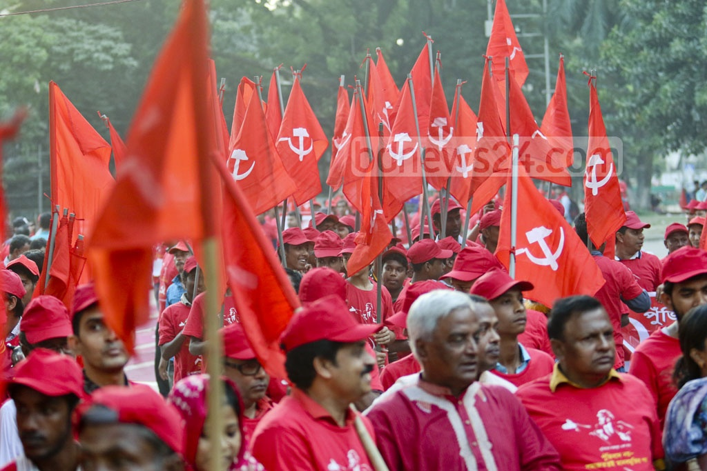 Workers Party activists carry red flags emblazoned with hammer-sickle symbol at a rally at the Central Shaheed Minar premises in Dhaka on Saturday to mark the centenary of the Russian Revolution. Photo: tanvir ahammed