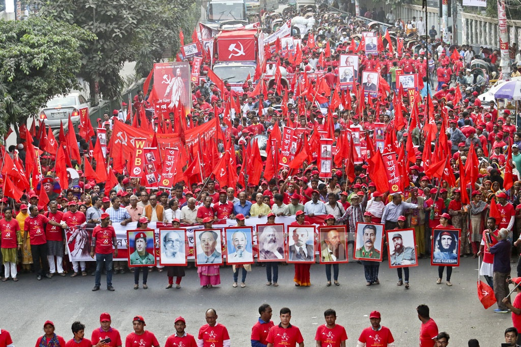 Workers Party activists carry a red flags emblazoned with hammer-sickle symbol and other slogans at a procession in Dhaka on Saturday to mark the centenary of the Russian Revolution. Photo: tanvir ahammed