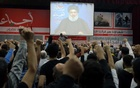 Lebanon's Hezbollah leader Sayyed Hassan Nasrallah is seen on a video screen as he addresses his supporters in Beirut, Lebanon Nov 10, 2017. Reuters