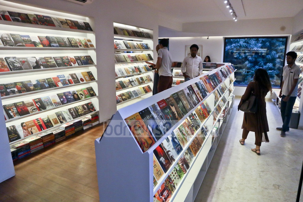Visitors take a tour inside 'Bengal Boi', a bookstore launched by the Bengal Foundation, at Dhaka's Dhanmondi on Tuesday. Photo: tanvir ahammed