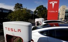 File photo: Tesla Model X cars are charged by superchargers at a Tesla electric car dealership in Sydney, Australia, May 31, 2017. Reuters