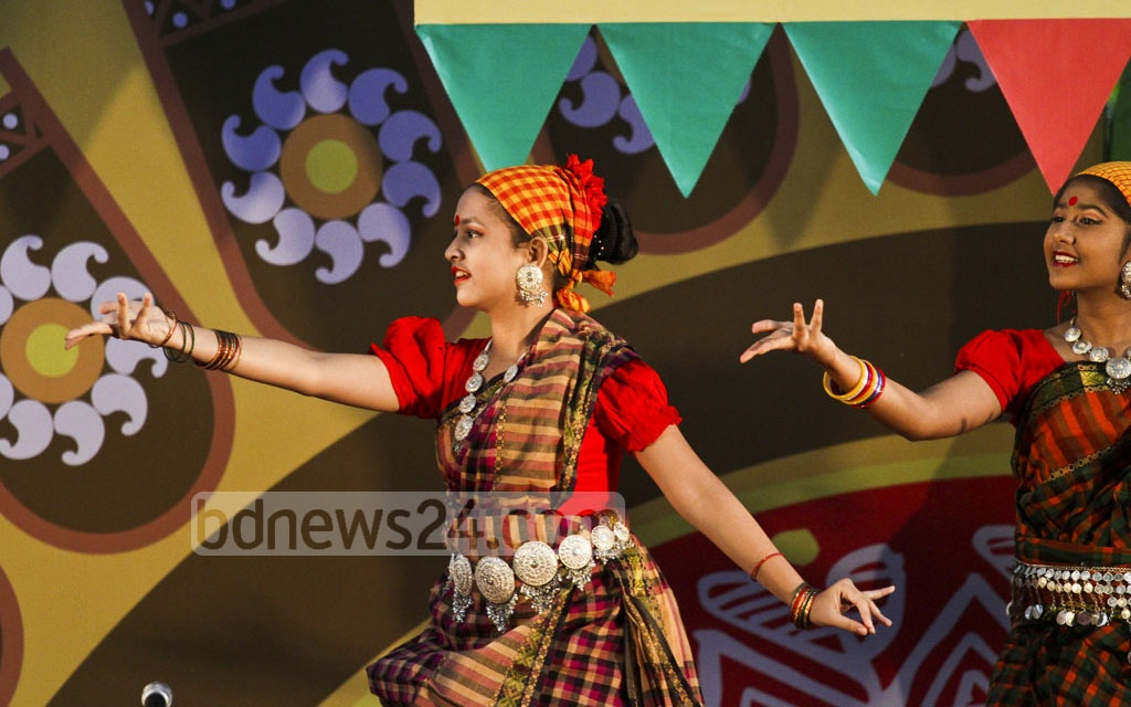 Artistes perform at a programme marking the 20th Nobanno Utsav at the Institute of Fine Arts in Dhaka on Wednesday. Photo: dipu malakar