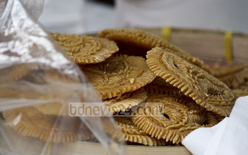Traditional sweets were on sale at the Nobanno Utsav at the Institute of Fine Arts in Dhaka on Wednesday. Photo: dipu malakar