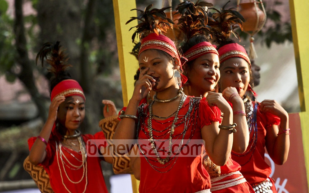 Ethnic groups perform at the celebrations of Nobanno Utsav held at the Institute of Fine Arts in Dhaka on Wednesday. Photo: dipu malakar