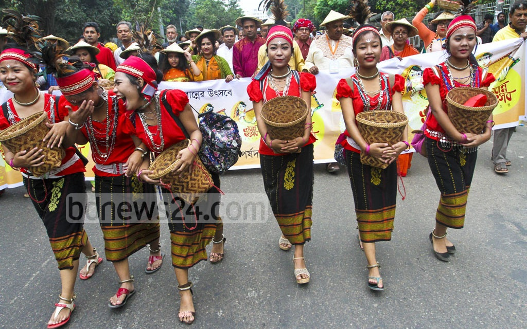 A rally passes through the Dhaka University campus to mark the Nobanno Utsav held at the Institute of Fine Arts on Wednesday. Photo: dipu malakar