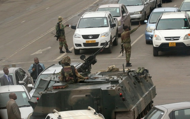 Military vehicles and soldiers patrol the streets in Harare, Zimbabwe, November 15, 2017.