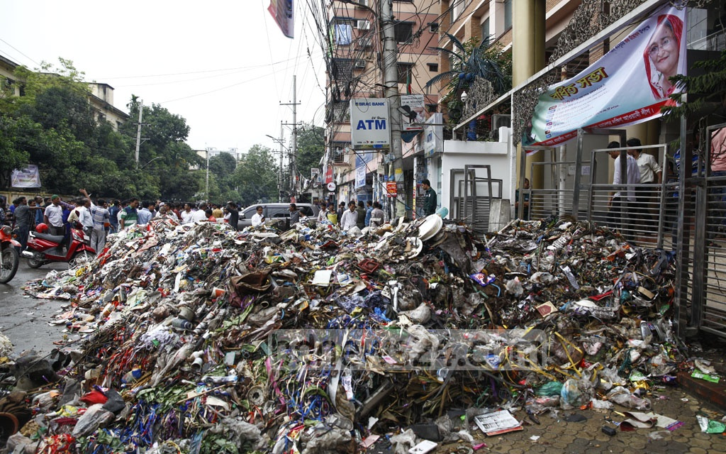 Garbage was dumped late on Wednesday in front of a community centre in Dhaka's Azimpur, where Awami League's Dhaka metro South unit's General Secretary Shahe Alam Murad was supposed to held an event on Thursday. Murad blames supporters of Dhaka South City Mayor Sayeed Khokon behind it.