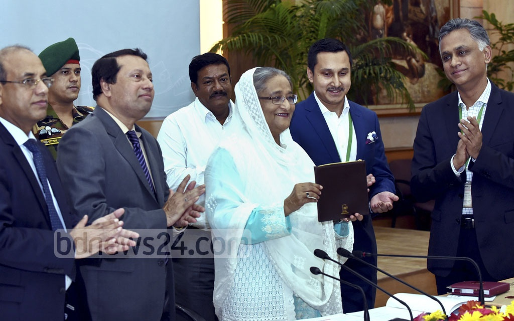 The organisers of Bangladesh Leather, Footwear and Leather Goods International Sourcing Show 2017 presents Prime Minister Sheikh Hasina leather goods as she inaugurates the event through a video call from the Ganabhaban on Thursday. The show at the International Convention City Bashundhara will end on Saturday. Photo: Saiful Islam Kallol