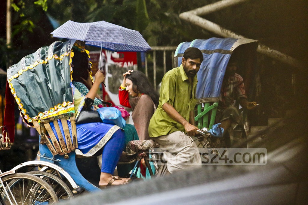 The residents of Dhaka carried umbrella on Thursday to protect themselves from drizzle. The photo was taken in Dhaka University area. Photo: tanvir ahammed