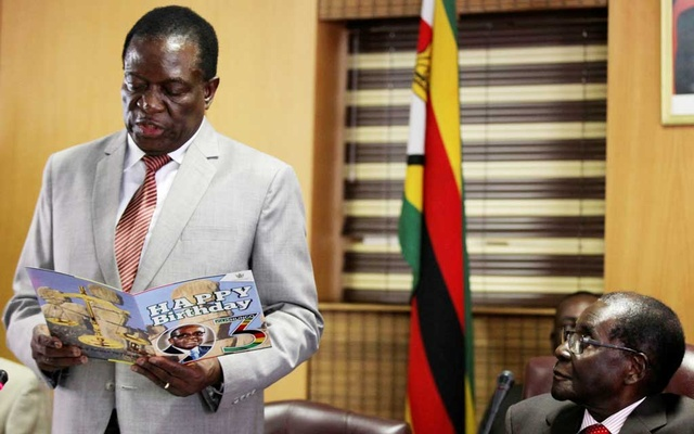 Robert Mugabe looks on as his deputy Emmerson Mnangagwa reads a card during his 93rd birthday celebrations in Harare, Zimbabwe, Feb 21, 2017. Reuters