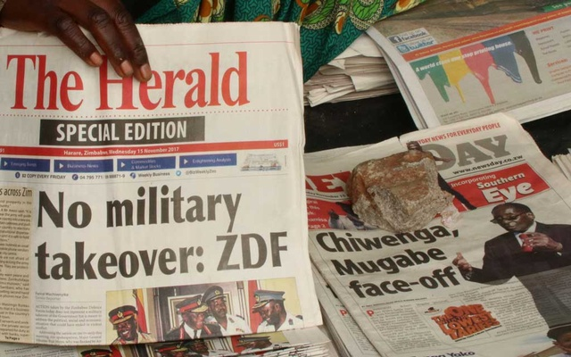 A vendor picks up a copy of a special edition of the state-owned daily newspaper The Herald in Harare, Zimbabwe Nov 15, 2017. Reuters