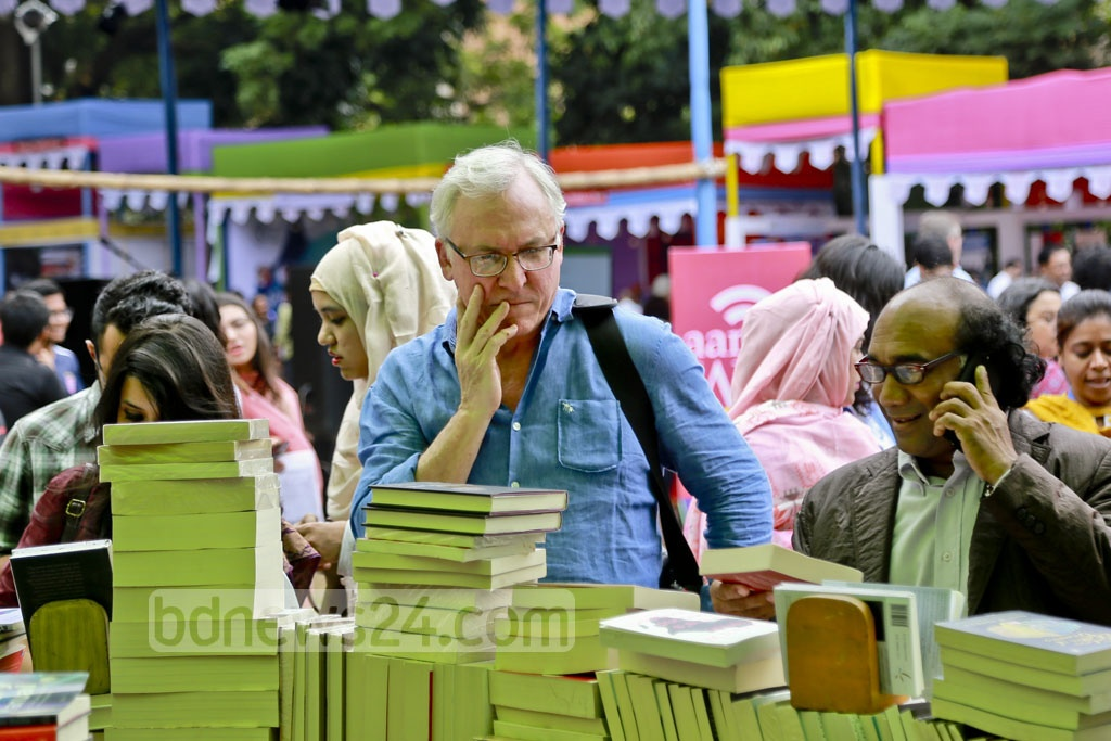 Foreigners are also among visitors browsing books at the stalls of Dhaka Lit Fest at the Bangla Academy premises in Dhaka on Friday.
