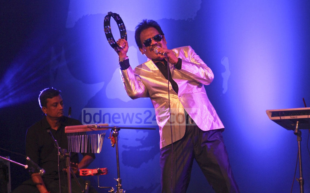 Singer Ferdous Wahid performing at a reception titled 'Gane Gane Gunijan Sangbardhana' arranged by Citi Bank NA at hotel Radisson in Dhaka on Friday. Photo: dipu malakar
