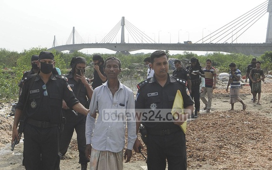A mobile court sends to jail for a month the owner of the illegally run fish and poultry farm built under Amanat Shah bridge in Chittagong. The court operation was conducted on Saturday with the help of RAB. Photo: suman babu