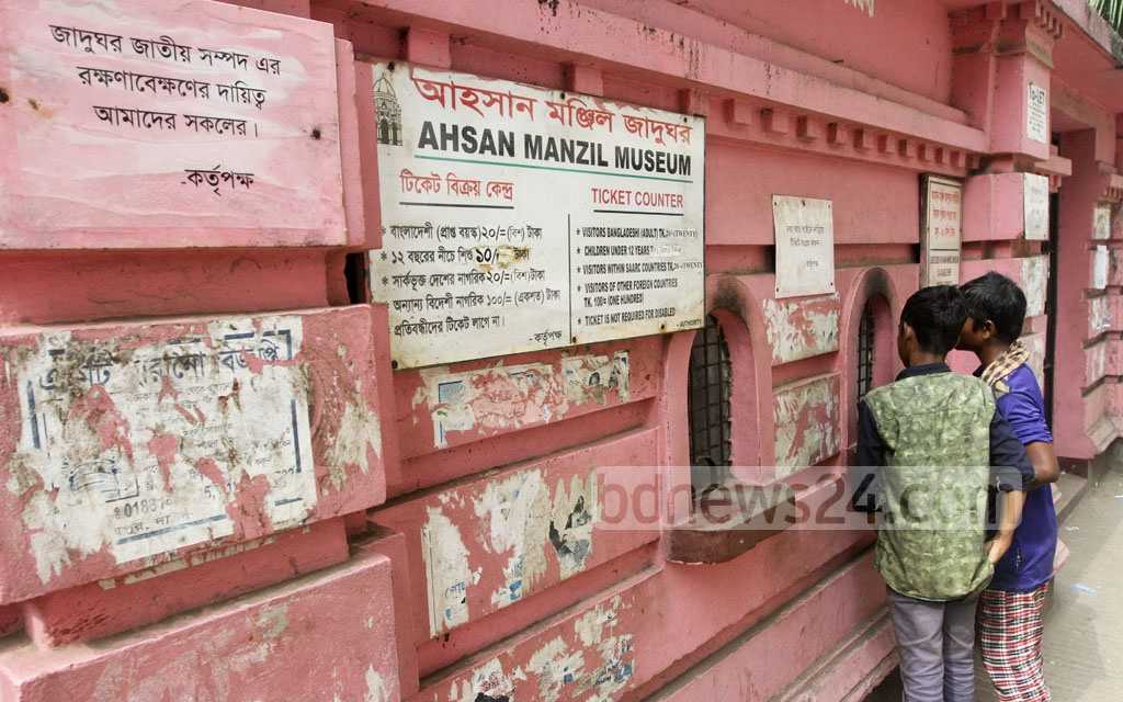 The wall of Ahsan Manzil ​is defaced with posters ​though it is prohibited​ed by regulations. The photo is taken on Saturday.