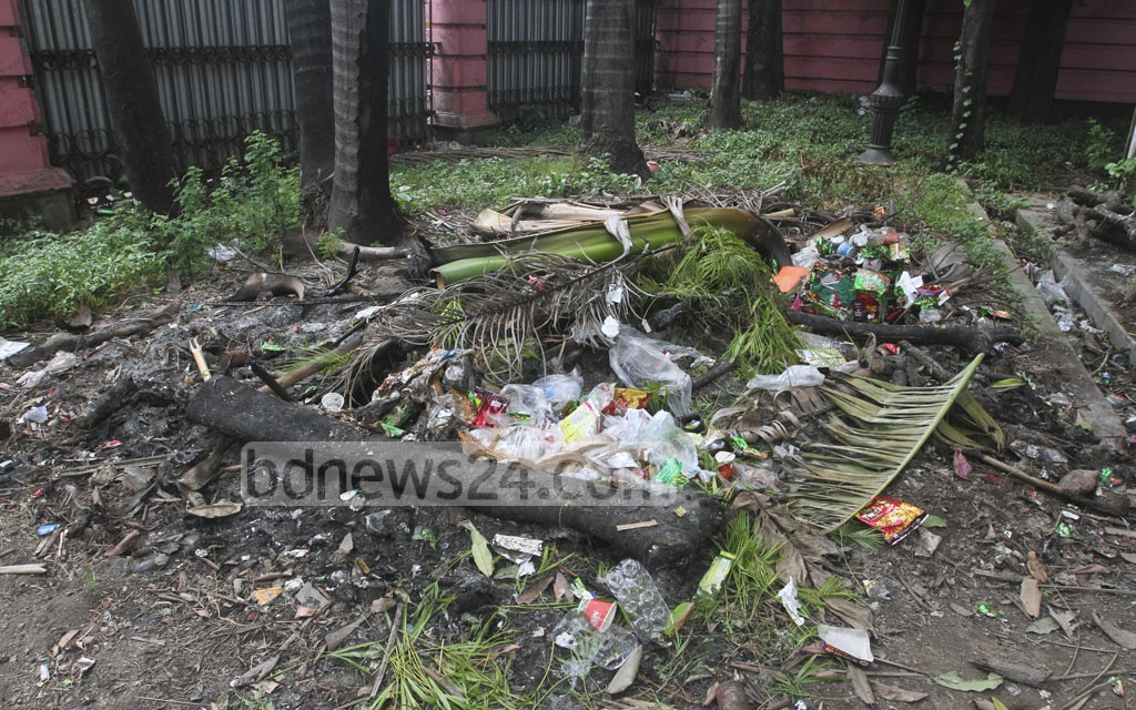 Garbage ​dumped after ​a recent programme ​has not yet been removed from the Ahsan Manzil premises. The photo is taken on Saturday.