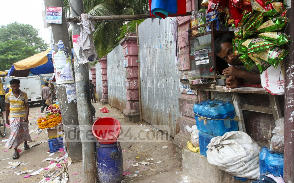 A shop​ encroached the boundary wall of the Manzil. The photo is taken on Saturday.
