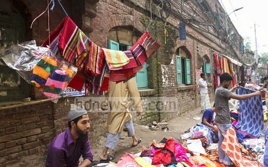 A trader displays his towels on a power line across from the Mitford Hospital in Old Dhaka. Photo: Dipu Malakar