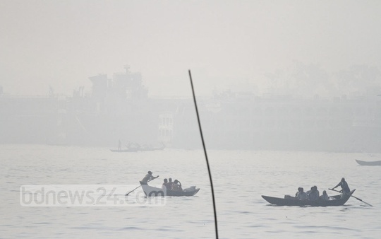 The Buriganga River is shrouded in fog near Dhaka's Shyambazar. Photo: dipu malakar