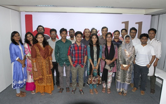 Child journalists pose for a photo with their senior newsroom managers of bdnews24.com on the Universal Children's Day.
