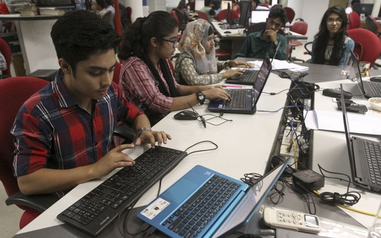 Five child journalists work at the newsroom of bdnews24.com on Monday to mark the Universal Children's Day.