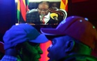People watch as Zimbabwean President Robert Mugabe addresses the nation on television, at a bar in Harare, Zimbabwe, November 19, 2017. Reuters