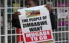 A man carries a poster calling for Zimbabwe President Robert Mugabe to step down as Zimbabweans take to the streets in Harare, Zimbabwe, Nov18, 2017. Reuters
