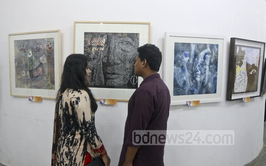 Visitors flock to the Berger Young Painters' Art Exhibition at the Institute of Fine Arts in Dhaka on Tuesday. Photo: tanvir ahammed