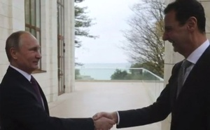 With hugs and smiles, Putin hosts Syria's Assad in Russia