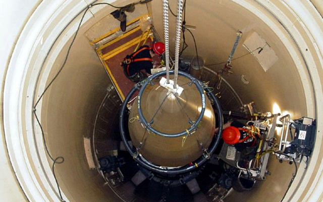 FILE PHOTO: A US Air Force missile maintenance team removes the upper section of an intercontinental ballistic missile with a nuclear warhead in an undated USAF photo at Malmstrom Air Force Base, Montana, US. US Air Force/Airman John Parie/Handout via Reuters