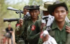 Army soldiers carry weapons as they walk to the earthquake struck area in Tarlay, Myanmar March 28, 2011. Reuters