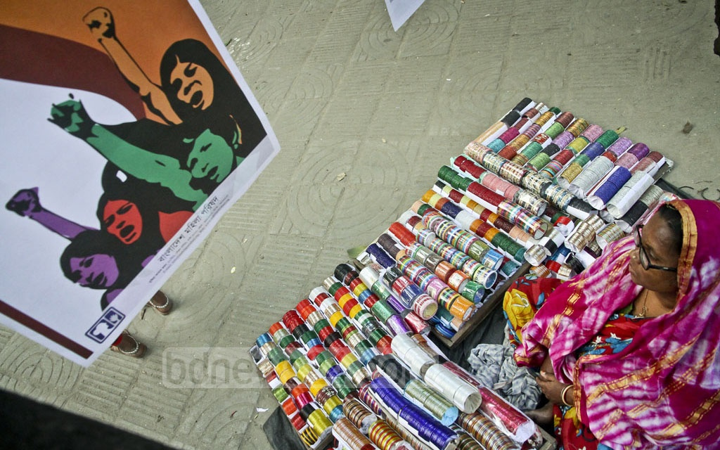 Posters are put on display at the Soparjito Shadhinota Chattar on Dhaka University Campus on Tuesday to raise awareness on sexual harassment and rape. Photo: tanvir ahammed