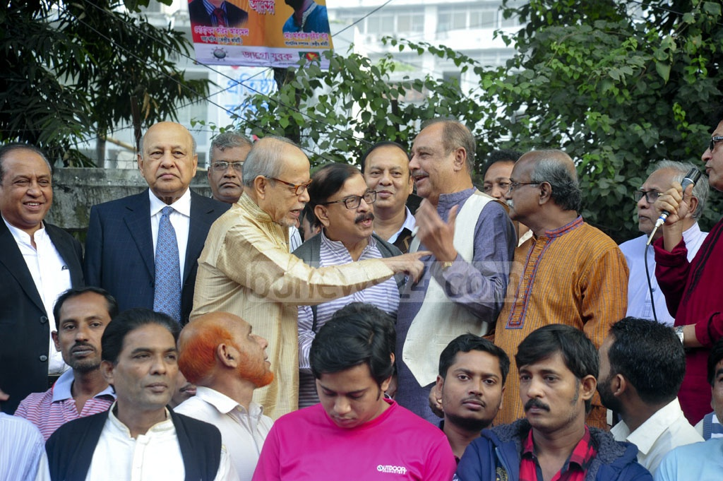 AQM Badruddoza Chowdhury, ASM Abdur Rob, and Mahmudur Rahman Manna speak among themselves at a demonstration in front of the National Press Club protesting the new hiked rates of retail power prices on Tuesday .