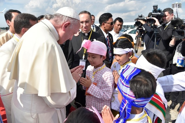 Pope Francis is welcomed as he arrives at Yangon International Airport, Myanmar November 27, 2017. Osservatore Romano/Reuters