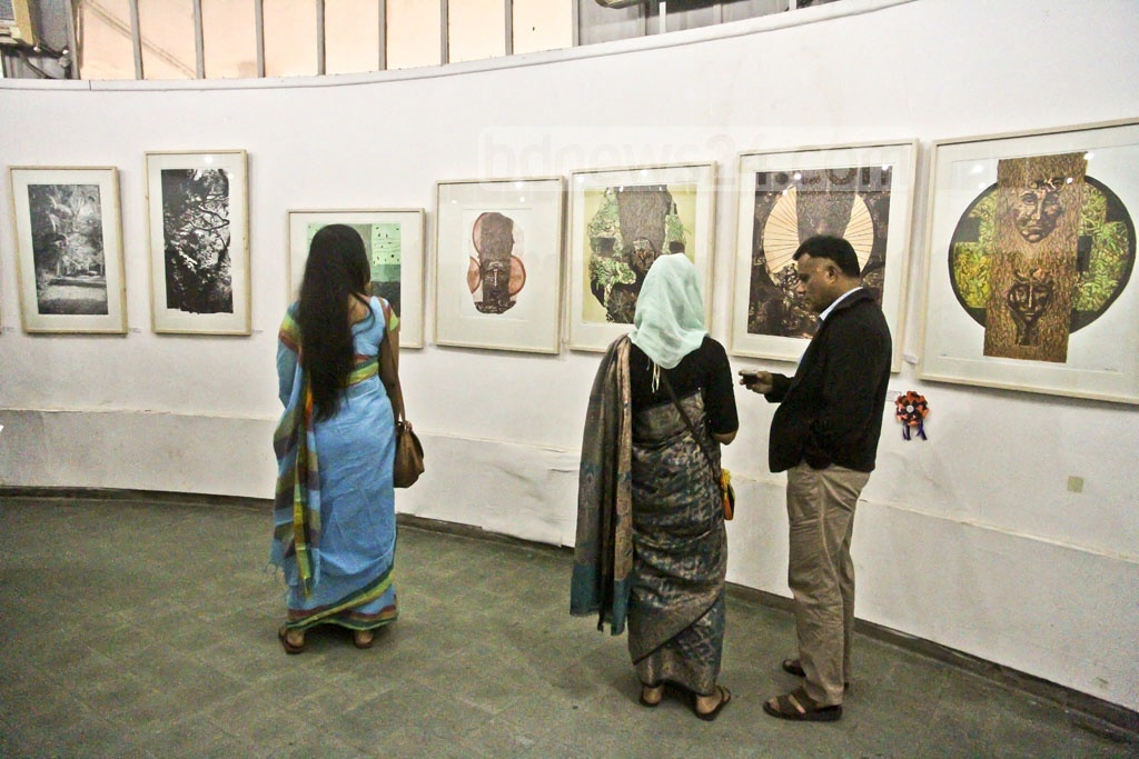 Visitors look at paintings at the annual art exhibition of Dhaka University's Faculty of Fine Arts on Wednesday. Photo: tanvir ahammed