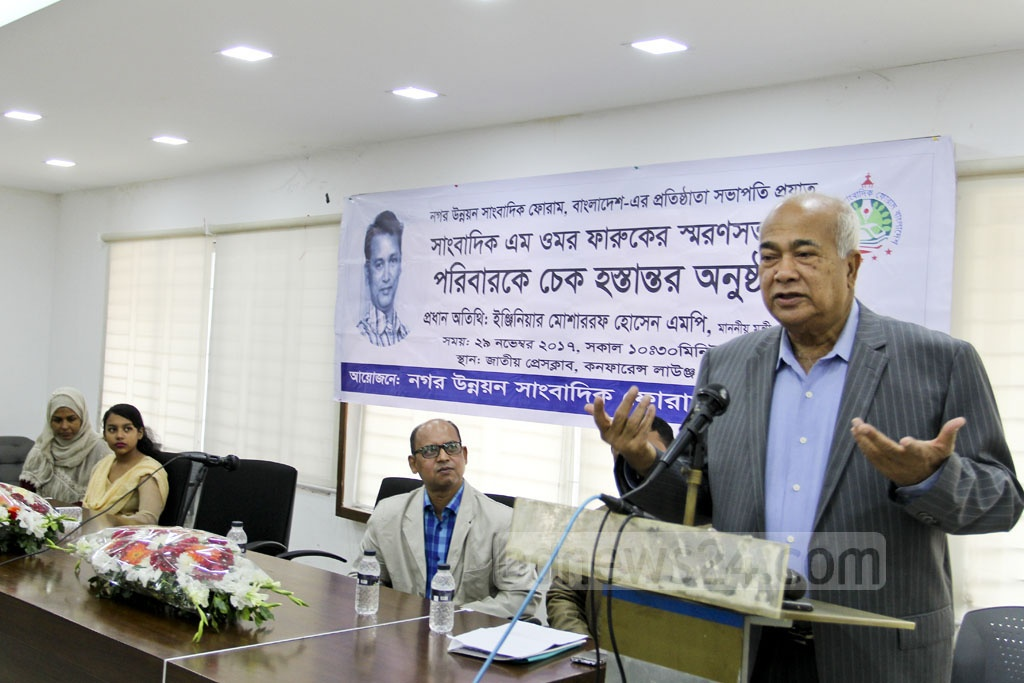 Housing and Public Works Minister Eng. Mosharraf Hossain addressing a programme by organised a journalists' forum at the National Press Club on Wednesday. Photo: asif mahmud ove