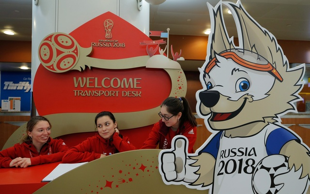 A board depicting Zabivaka, the official mascot for the 2018 FIFA World Cup, is seen in front of a welcome desk for the cup's Final Draw at Sheremetyevo International Airport outside Moscow, Russia November 27, 2017.
