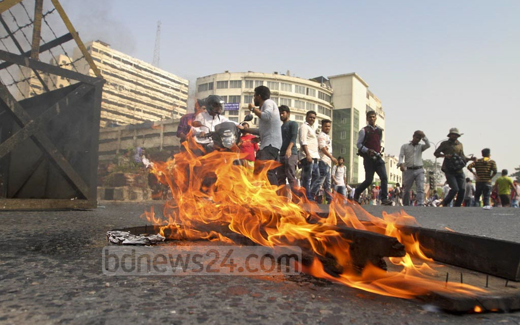 Activists of leftist parties set a fire on the street at Dhaka's Shahbagh during a half-day general strike on Thursday protesting against the government's decision to raise the price of electricity. Photo: dipu malakar