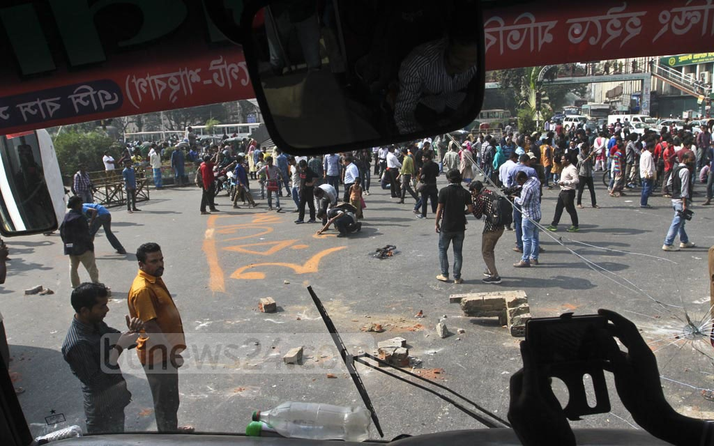 Leaders and activists of left-leaning parties occupy the Shahbagh intersection on Thursday during their half-day general strike called to protest against the government's decision to raise the power price. Photo: dipu malakar
