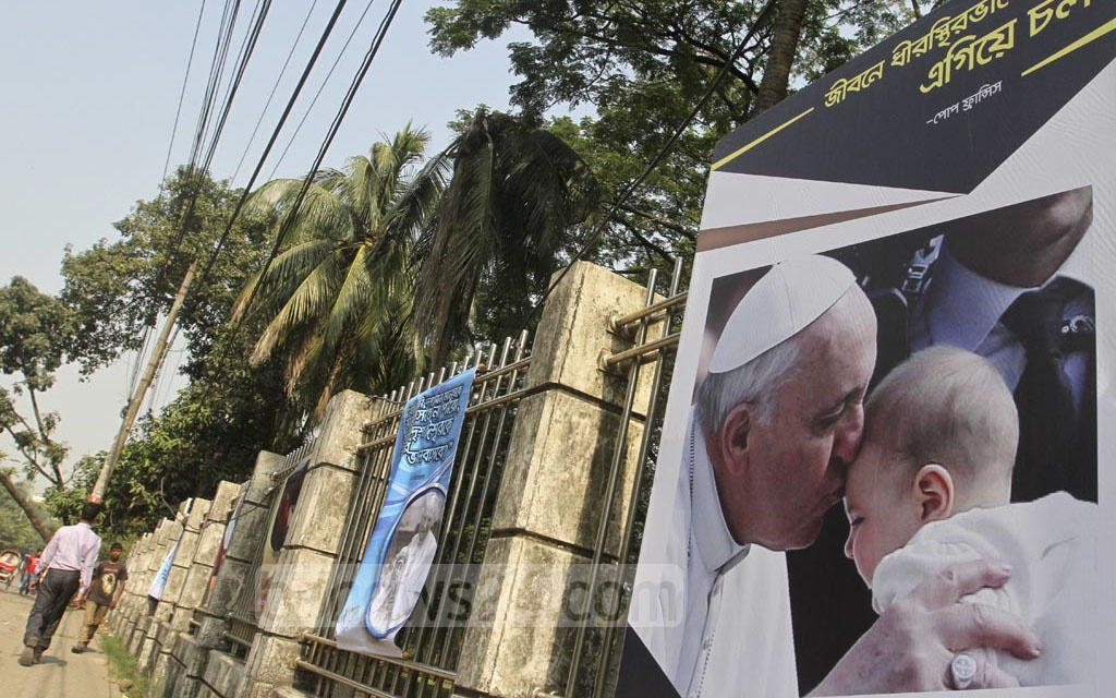Dhaka streets adorned with posters carrying the pope's pictures and messages as Pope Francis, the leader of the Roman Catholic Church, landed in the Bangladesh capital on Thursday. Photo: dipu malakar